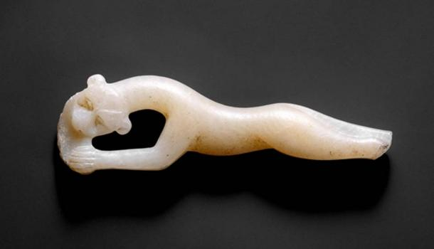 This exquisite alabaster handle of a cosmetic spoon in the form of a leaping leopard was discovered in the Malqata Palace of Amenhotep III in western Thebes. 18th Dynasty. (Metropolitan Museum of Art)