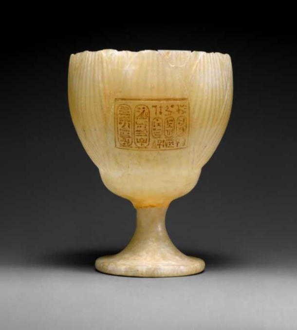 This graceful, translucent drinking cup made of Travertine (Egyptian alabaster) is in the form of a white lotus blossom. It is inscribed with the names of Amenhotep IV and Queen Nefertiti, suggesting the vessel must have been made before Year 5 of the king's reign, when he changed his name to Akhenaten. Metropolitan Museum of Art