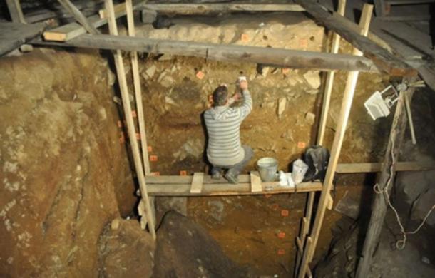 This is Flinders University researcher Dr Mike Morley taking samples from Denisova Cave complex.           (Dr. Paul Goldbert, University of Wollongong /EurekAlert!)