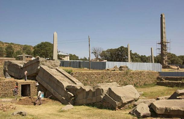 """This photo shows part of the North Stelae Park in Axum, Ethiopia. To the left are the shattered remains of the Great Obelisk, on the right is the 27-meter tall (some would say 23-meter tall) obelisk called """"King Ezana's Stelae."""" (Magnus Manske / CC BY-SA 2.0)"""