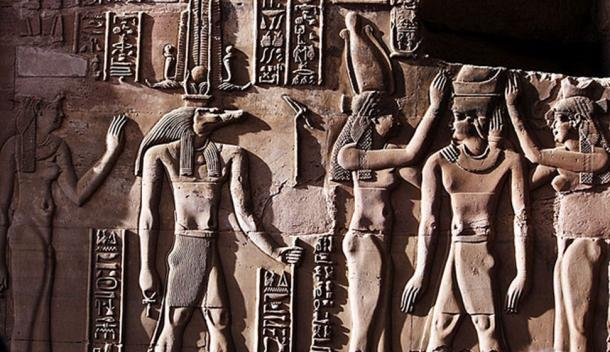 This relief from the Temple of Kom Ombo shows Sobek with typical attributes of kingship, including a was-scepter and royal kilt. The ankh in his hand represents his role as an Osirian healer and his crown is a solar crown associated with one of the many forms of Ra. Source: (Hedwig Storch / CC BY-SA 3.0)