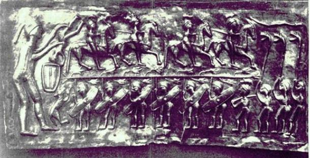 Three carnyx players are depicted at right on plate E of the Gundestrup cauldron.