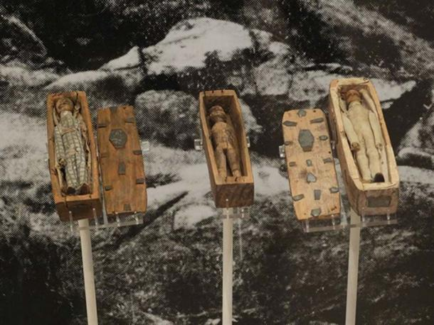 Three of the miniature coffins on display in the National Museum of Scotland.