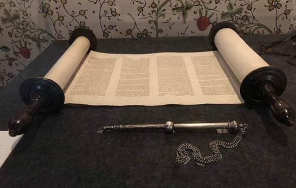 A hand-written Sefer Torah, or Torah Scroll, with a yad pointer stick before it. Now in the State Library of Victoria. (Azoma, CC BY-SA 4.0)