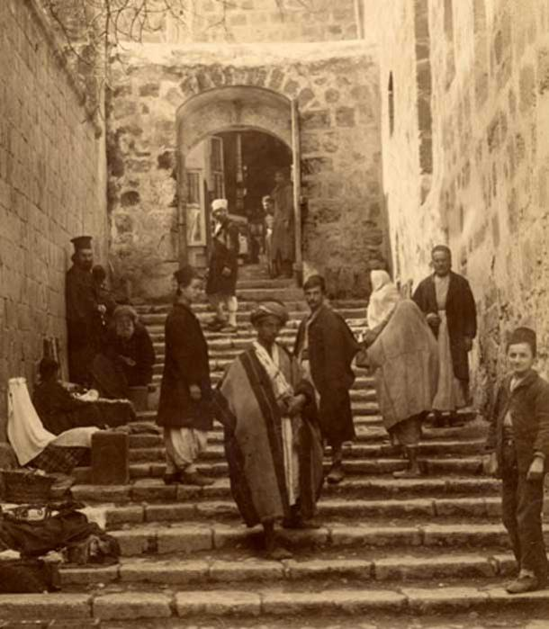 Tourists and pilgrims at a side entrance to the Holy Sepulchre, photo by Bonfils, 1870s.