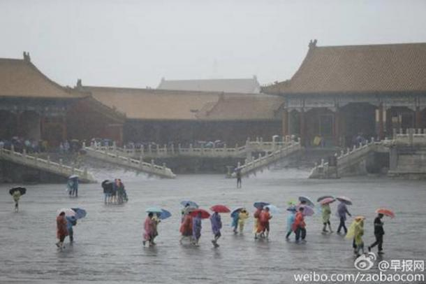 Tourists stream into the ancient Forbidden City in Beijing on July 20, as violent rainstorms ground the capital of China to a halt.