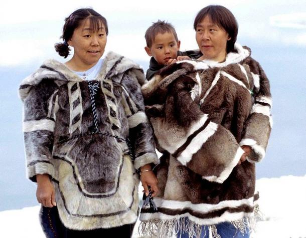 Traditional clothing left: seal, right: caribou