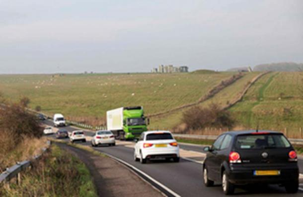 Traffic on the A303, with Stonehenge in the background.