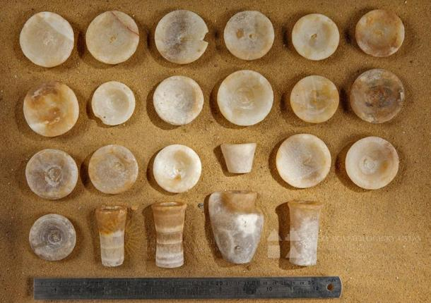 Travertine model vessels unearthed at the tomb of Khentkaus III, Abusir, Egypt.