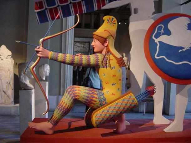 """Trojan archer (so called """"Paris""""), figure W-XI of the west pediment of the Temple of Aphaia, ca. 505–500 BC Polychrome reconstruction from the exhibition Bunte Götter."""