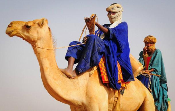 Tuareg men in traditional dress in the Saharan Desert of Mali.