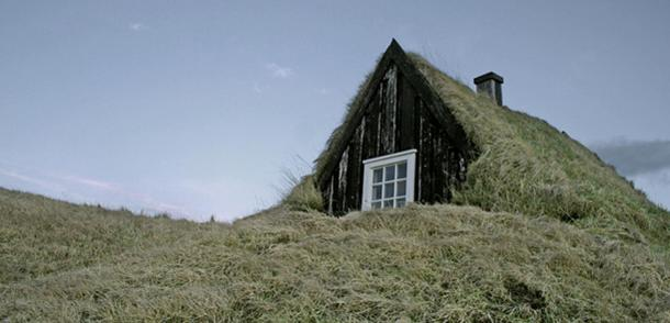 Turf house with a wooden gafli in Iceland.