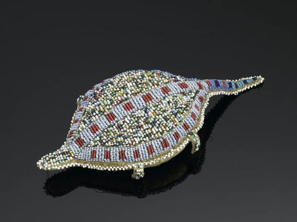 "Turtle shaped amulet, Sioux People of North America. (1880-1920) ""Decorated with beading, this turtle-shaped amulet made from animal hide is thought to contain an umbilical cord."