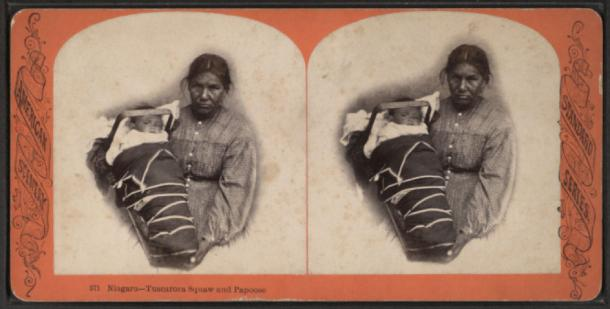 A 19th century Tuscarora mother with her baby in a papoose. (Public Domain)