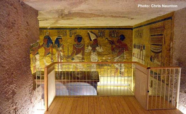 Tutankhamun's burial chamber, looking in from the Antechamber. Straight ahead, the north wall shows various funerary scenes involving the deceased pharaoh. The modest size of KV62 and its sparse and hurried decoration have for long baffled Egyptologists.