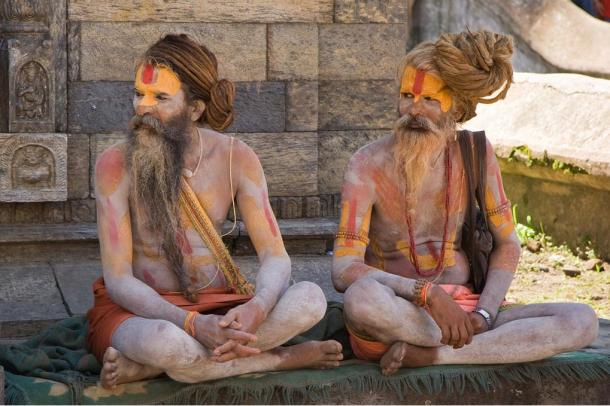 Two Hindu sadhus near Pashupatinath Temple in Kathmandu, Nepal. Usually sadhus live by themselves, on the fringes of society, and spend their days in their pursuit of moksha / mukthi
