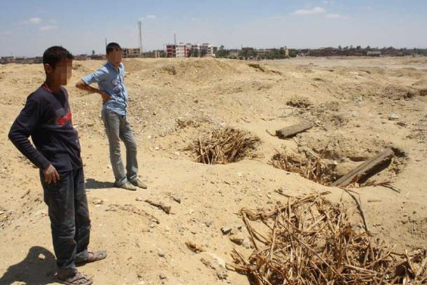 Two children in the looted cemetery at Abusir el-Malek, Egypt.