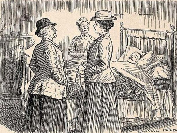 Two female doctors discussing a patient.