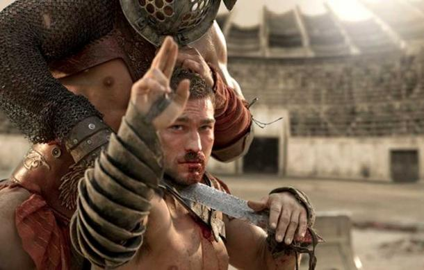 "Spartacus performing a ""Two-fingered salute."""