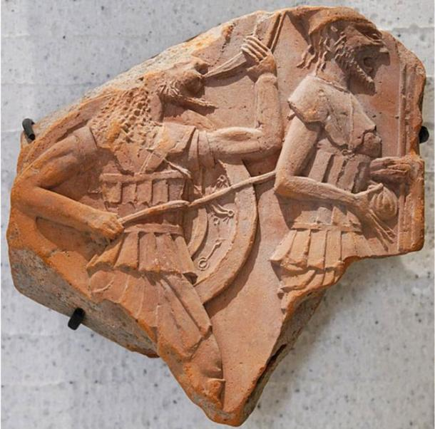 Two hoplites, armed foot-soldiers in ancient Greece, wearing breastplate and armed with javelins and spears. 600 – 500 BC.