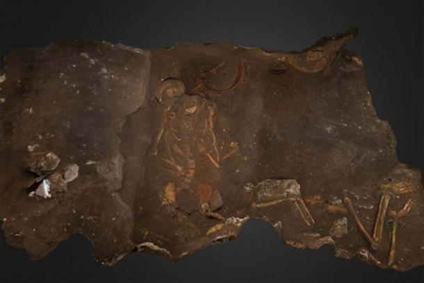 Two of the three members of the more elite family burial depicted as archaeologists discovered them.
