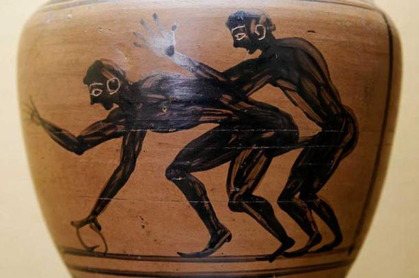 Two youths engaged in sex, one of them holding a hoop. Detail from an amphora