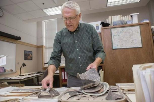 UC archaeologist Alan Sullivan examines sherds of pottery from sites outside Arizona's Grand Canyon National Park (Image: Joseph Fuqua II/UC Creative Services)