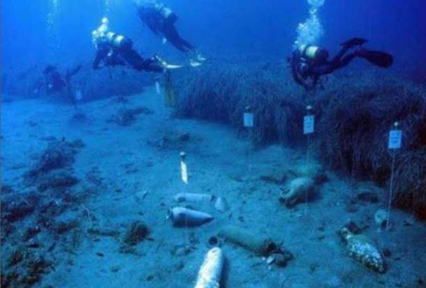 Underwater archaeologists and some of the other artifacts found at the site.
