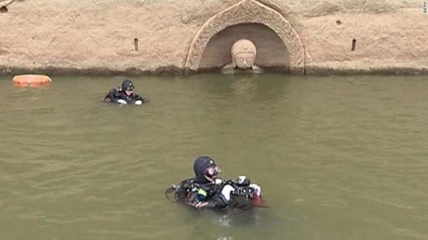 Underwater archeologists investigating the site.
