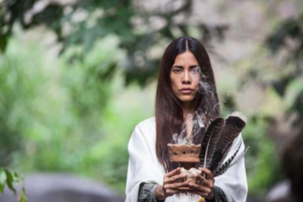 Native American woman performing a ritual. (topshots /Adobe Stock)