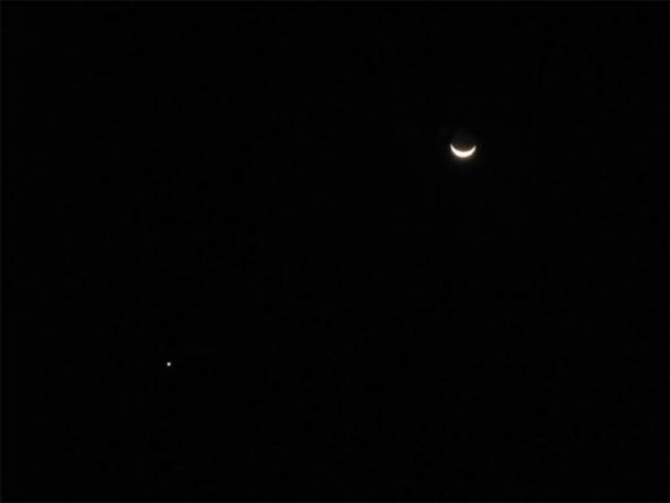 Uranus by a crescent moon. (Leonora (Ellie) Enking /CC BY SA 2.0)