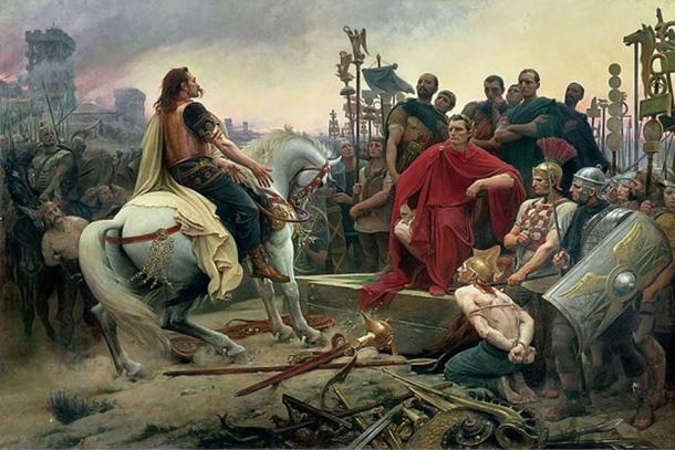 Vercingetorix throws down his arms at the feet of Julius Caesar, by Lionel Royer (1899). Painting depicts the surrender of the Gallic chieftain after the Battle of Alesia in 54 BC. (Public Domain).