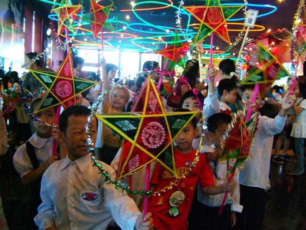 Vietnamese Children celebrating the Mid-Autumn Festival with a traditional lantern procession.