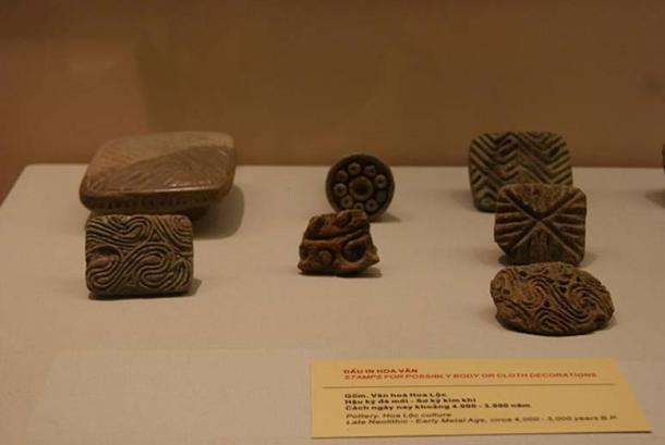 Vietnamese terracotta pieces possibly used to create patterns on cloth (Hoa Loc culture, circa 4000 – 3000 BC).