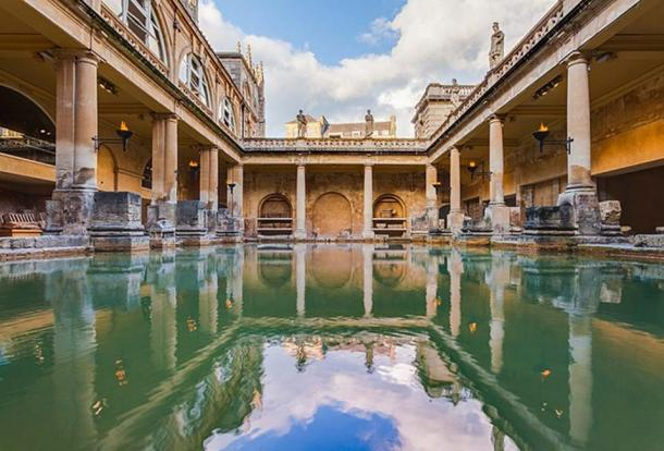 View of the Great Bath, part of the Roman Baths complex, a site of historical interest in the city of Bath, England. The baths, based on the local hot springs, were built during the Roman occupation of Britain and have become a major touristic site. (Diego Delso/CC BY SA 4.0)