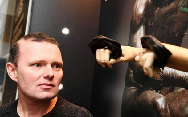 Vindolanda Trust's CEO, Dr. Andrew Birley next to the Roman boxing gloves on display at the museum
