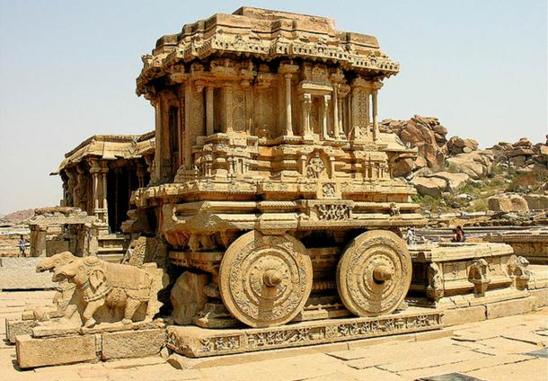 In front of the Vittala Temple of Hampi, India is the world famous stone chariot or ratha. This is one of three impressive stone chariots in India, the other two found in Konark and Mahabalipuram. The wheels of the ratha could originally be rotated, but they were fixed in place by the government to avoid future damage by visitors.
