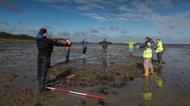 Volunteers mark the outline of the wreck on Tankerton Beach. (Image: Timescapes)