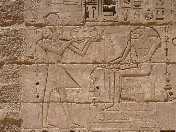 Wall relief of Amun receiving gifts from Ramses III, mortuary temple of Ramses III, Medinet Habu, Theban Necropolis, Egypt, 2009 Phot by Remih