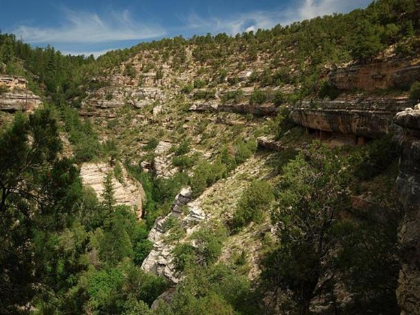 The view up Walnut Creek from the Island Trail at Walnut Canyon National Monument. Ancient cliff dwellings of the Sinagua people can be seen under the rock overhangs on both sides of the canyon.