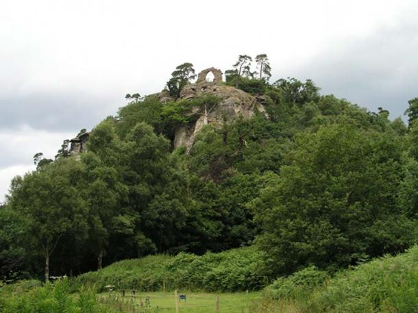 The White Cliff at Hawkstone Park. The cave containing the statues is just below the ruined arch.