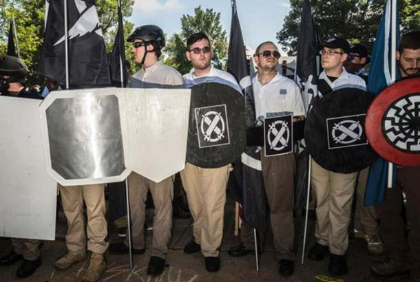 White supremacists standing by the statue of Robert E. Lee, before the crash in Charlottesville. Credit: Go Nakamura
