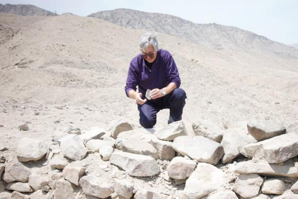 William James Veall examines a large, debris filled, 'pit' at the southern end of the chain of indents known as the 'Mysterious Holes of Peru'.