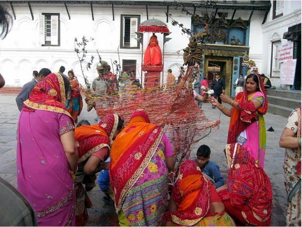 Women preparing the Holika Dahan bonfire, Kathmandu, Nepal