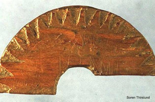 Wooden fragment discovered in Uunartoq, Greenland, in 1948, which is believed to be a sun-compass used to determine direction. Image credit: Soren Thirslund.