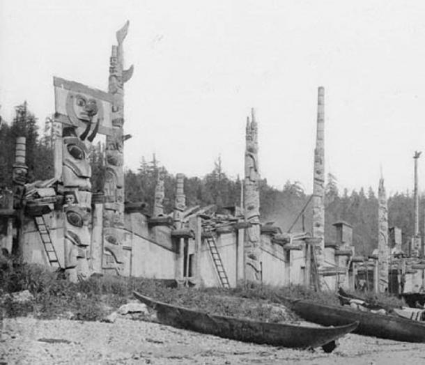 Wooden totem poles at the Skidegate Indian Village of the Haida tribe. Skidegate Inlet, British Columbia, Canada, 1878. (Public Domain)