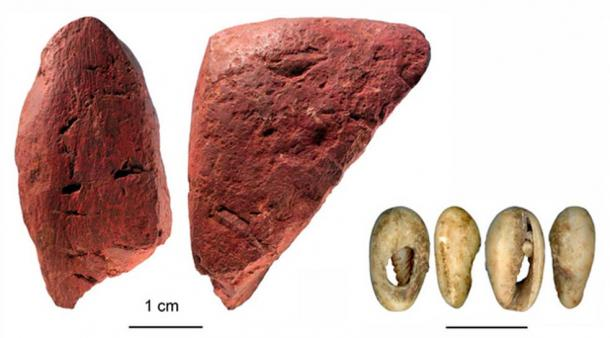 Worked red ochre (left) and beads made of a marine shell (right). Credit: Francesco D'Errico and Africa Pitarch