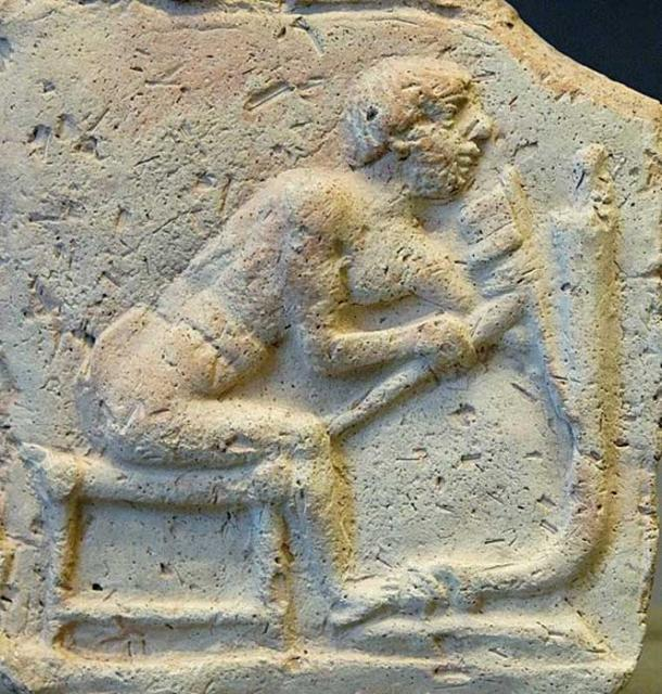 Worker using an adze for cutting a piece of a chariot. Terracotta relief, early 2nd millennium BC. From Eshnunna. (Marie-Lan Nguyen/CC BY SA 2.5)