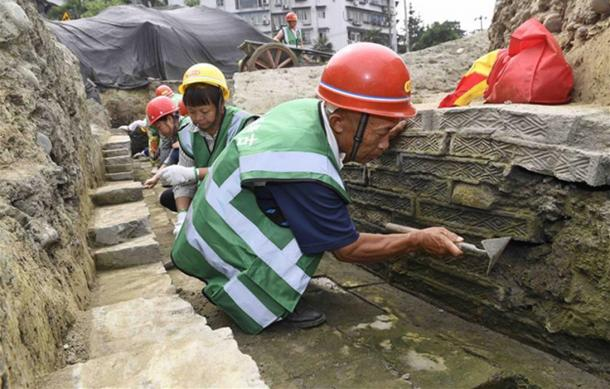 Workers inside an unearthed ditch at the excavation site of the Fugan Temple, Chengdu, China.