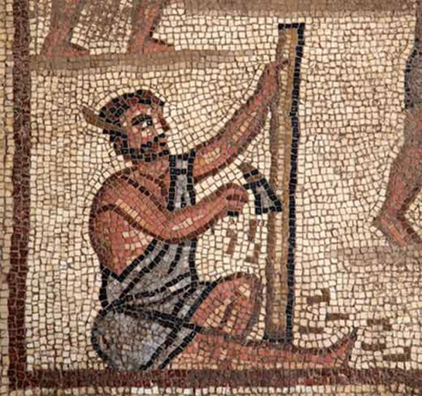 Workman chiseling wood in the Tower of Babel panel found in 2017. (Israel Antiquities Authority)